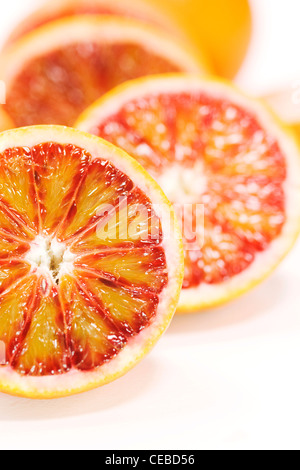 Citrus x sinenesis. Blood Orange halves on a white background. - Stock Photo