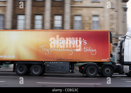 A Sainsbury truck traveling along a road in London - Stock Photo