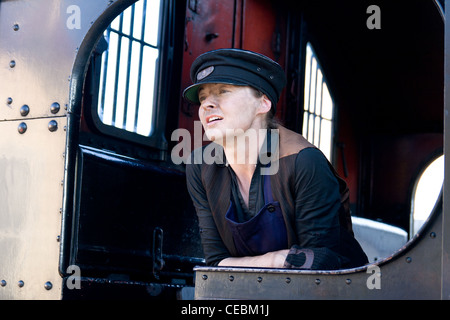 Steam locomotive pulling a train on the Llangollen Railway with the female engine driver looking out of the cab - Stock Photo