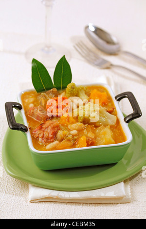 Stewed white beans with vegetables and chorizo. Recipe available. - Stock Photo