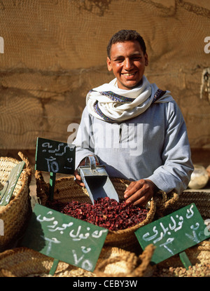 Boy spice seller in Souk, Luxor, Luxor Governorate, Republic of Egypt - Stock Photo