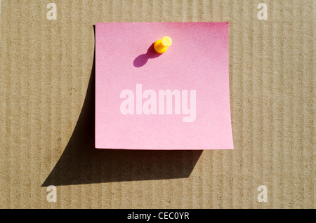 pink color note paper with pin - Stock Photo