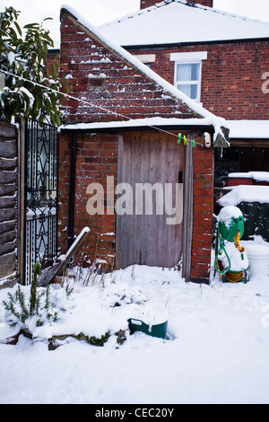 Semi Detached Victorian House in the Snow - Stock Photo