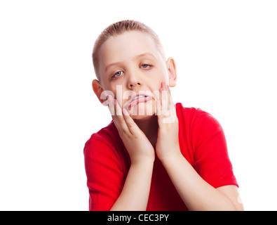 naughty child making faces, isolated against white background - Stock Photo