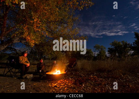 Sitting around the campfire at Gist Bottom campsite in the Upper Missouri River Breaks National Monument, Montana, - Stock Photo