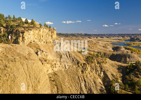 Hiker takes in the view at the Upper Missouri River Breaks National Monument, Montana, USA MR - Stock Photo