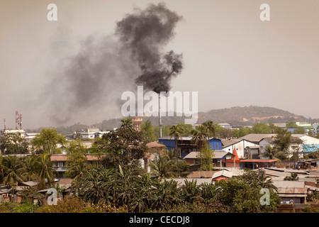 India, Assam, Guwahati, Amingaon, Assam Export Promotion Industrial Park (EPIP) chimney emitting black smoke - Stock Photo