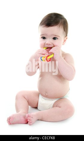 Baby biting on rattle - Stock Photo