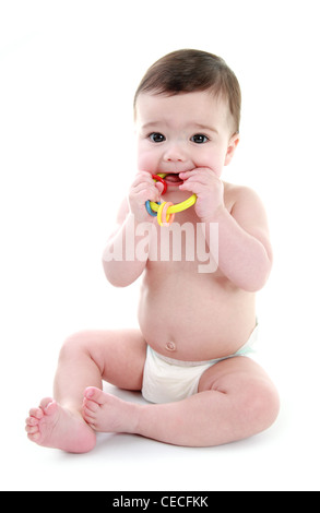 Baby biting on teether - Stock Photo