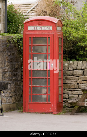 Traditional, iconic, red telephone box (kiosk no 6 or K6) an amenity in rural village (dirty glass panes) - Burnsall, - Stock Photo