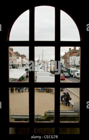 Looking through a window down onto Northallerton's high street on market day. - Stock Photo