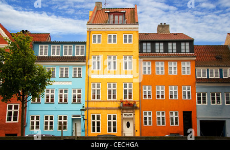 Color photograph of buildings along the old port Nyhavn in Copenhagen. 17th century waterfront, canal and entertainment - Stock Photo