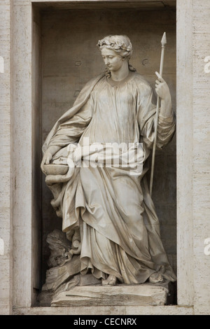 A Statue of a lady holding a stave outside St. Peter's Basilica Basilica di San Pietro Vatican city Rome - Stock Photo