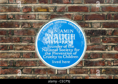 Blue plaque commemorating Benjamin Waugh, the founder of the NSPCC, in Greenwich, England. - Stock Photo