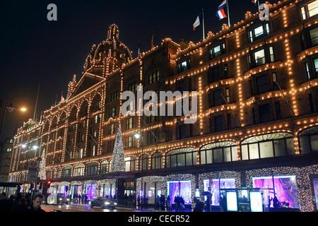 united kingdom london knightsbridge brompton road harrods store illuminated at night - Stock Photo
