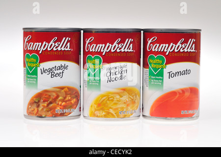 Unopened cans of Campbells healthy request vegetable beef, chicken noodle & tomato soups on white background isolate - Stock Photo