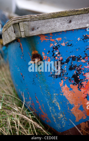 Close up of forward part of small orange and blue rowing boat - Stock Photo