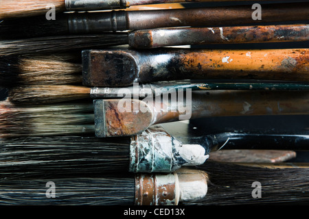 A collection of assorted old paint spattered paint brushes used for specialist paint finishes such as graining and - Stock Photo