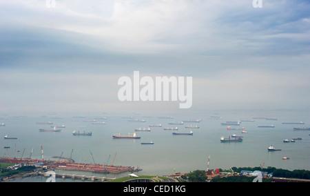 A lot of ships near the Singapore harbor - Stock Photo