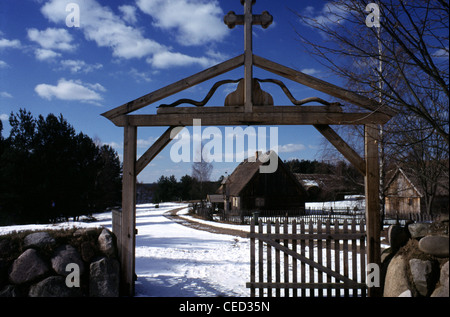 Wooden gateway to a small village in Masuria a natural region in northeastern Poland - Stock Photo