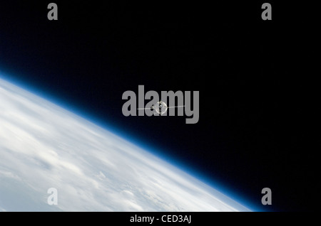 Soyuz TMA spacecraft approaching International Space Station - Stock Photo