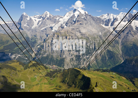 Horizontal wide angle of the Schilthorn cable car cables with spectacular views of the Jungfrau, Mönch and Eiger - Stock Photo