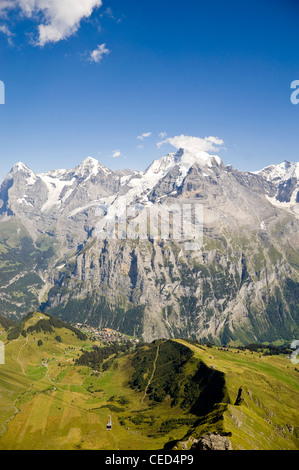 Vertical view of the Schilthorn cable car with spectacular views of the Jungfrau, Mönch and Eiger on a bright sunny - Stock Photo
