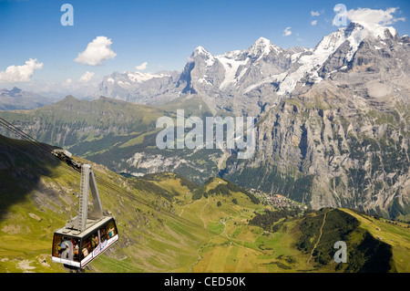 Horizontal wide angle of the Schilthorn cable car with spectacular views of the Jungfrau, Mönch and Eiger on a bright - Stock Photo