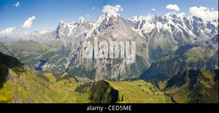 Horizontal (2 picture stitch) panoramic view of the Bernese Alps on a clear day with the Jungfrau, Mönch and Eiger - Stock Photo