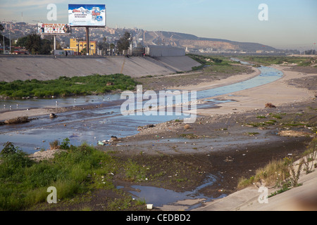 The Polluted Tijuana River as It Enters the United States from Mexico - Stock Photo
