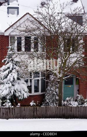 A 1930s Semi detached house in winter snow. Cambridge. England. - Stock Photo