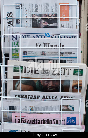 Foreign newspapers for sale outside King's News newsagents shop store in Cambridge , Cambridgeshire , England. - Stock Photo