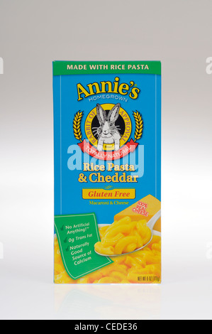 Box of Annie's Homegrown gluten-free natural macaroni and cheddar cheese rice pasta on white background, cutout. - Stock Photo