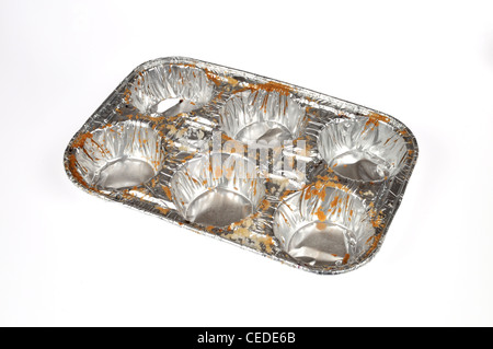 Empty muffin aluminum foil 6 pack tin on white background cutout - Stock Photo