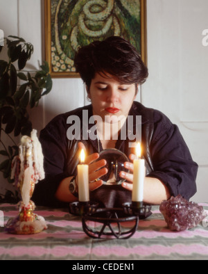 Female fortune-teller reading crystal ball, London, England, United Kingdom - Stock Photo