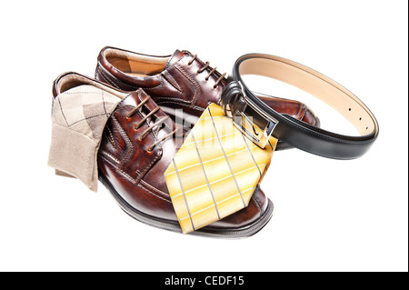 Brown leather dress shoes with argyle socks and a black belt - Stock Photo