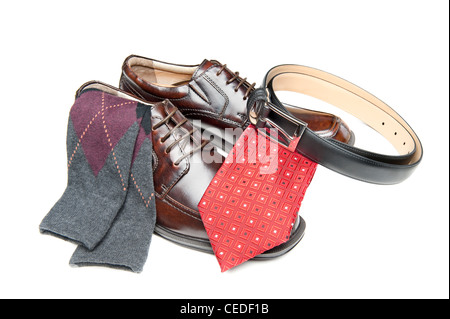 New brown leather shoes with red necktie and Argyle socks on white - Stock Photo