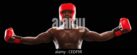African American boxer in protective gear - Stock Photo