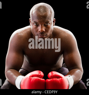 African American boxer wearing boxing gloves - Stock Photo