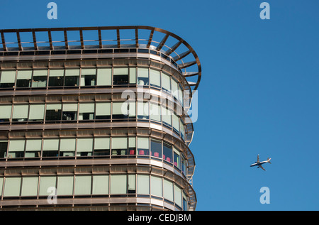 Embraer 170/190 Airplane and Office Building at 20 Canada Square, Canary Wharf, Docklands, London, United Kingdom - Stock Photo