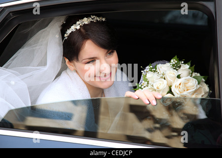 smiling bride in the car - Stock Photo