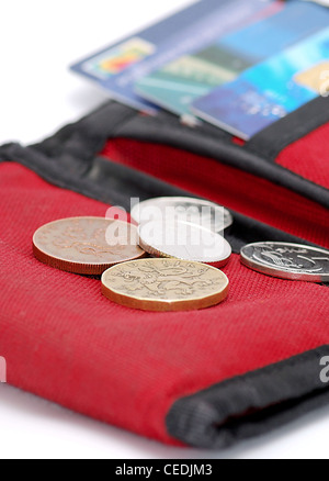 Detail image of red wallet with cards and coin. - Stock Photo