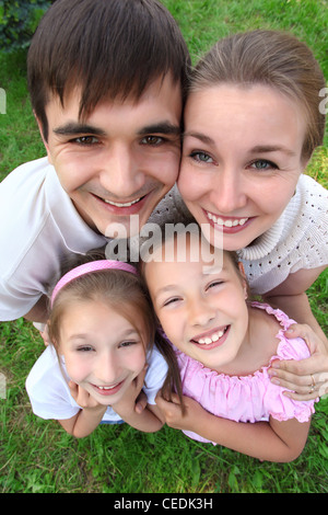 Parents stand having embraced children outdoor,  top view, wide angle - Stock Photo