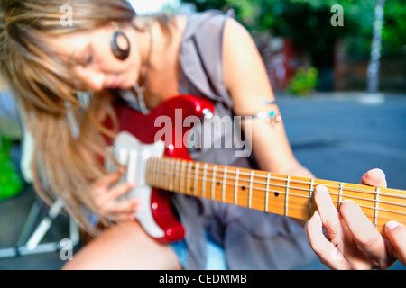 Woman playing guitar - Stock Photo
