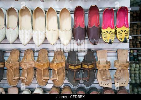 India, Delhi, Ballimaran Market, sandals for sale - Stock Photo