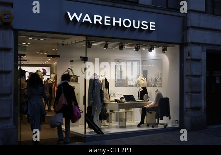 The front and entrance to a Warehouse store in London and people entering - Stock Photo