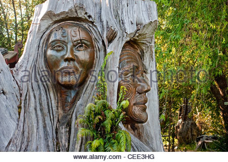 Maori carvings are often found in the parks of New Zealand - Stock Photo