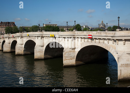 Pont Neuf crossing the River Seine in Paris France - Stock Photo