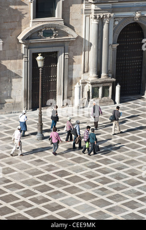 Tourists walking in the city centre of Granada, Andalucia, Spain - Stock Photo