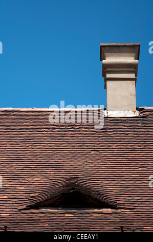 old terracotta style ceramic roof tiles on an old home in Budapest, Hungary - Stock Photo
